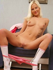 Angelic blonde spreads her pussy