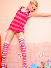 Cute petite short haired blonde in stripey socks