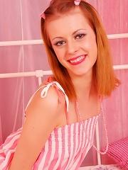 Sexy redhead teen posing