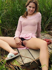Petite brunette girl spreads to show her sweetness